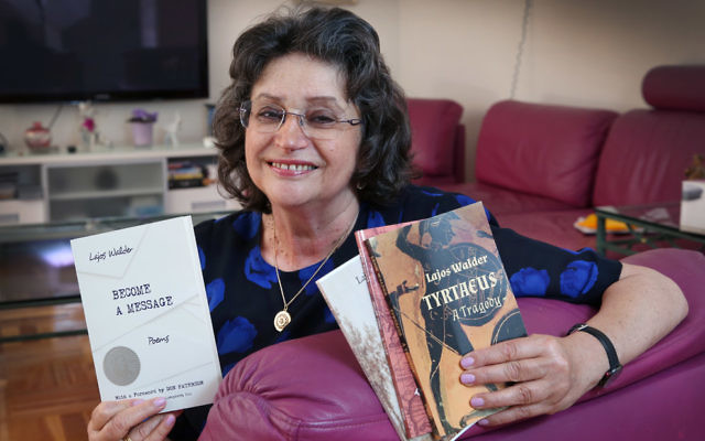 Agnes Walder with the books of poetry and plays written by her father, Lajos Walder, that she translated from Hungarian to English. Photo: Noel Kessel