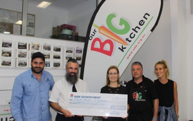 From left: Gabrielle Upton (centre) presenting the $15,000 to OBK's Charlie Rabie, Rabbi Dr Dovid Slavin, George Karounis and Shannon Cohen.
