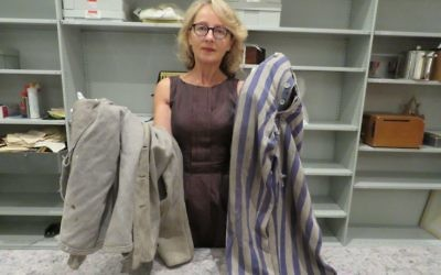 SJM head curator Roslyn Sugarman with the pair of Auschwitz prisoner's pants and jacket donated by the Klunicki family last week. Photo: SJM