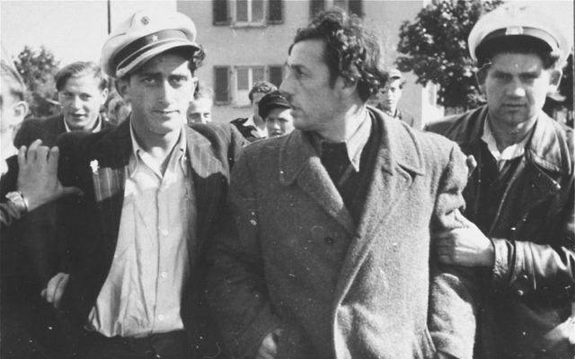 Jewish police detain a former Kapo who was recognised in the street at the Zeilsheim displaced persons' camp in Germany. (US Holocaust Memorial Museum, courtesy of Alice Lev)
