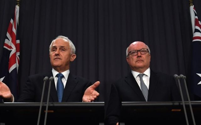PM Malcolm Turnbull and Attorney-General George Brandis discussing the proposed amendment to Section 18C on Tuesday. Photo: AAP Image/Sam Mooy
