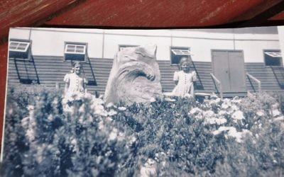 Local girls posing with the original memorial sculpture at Tatura.