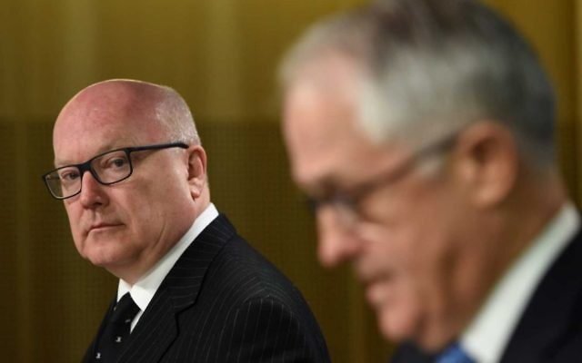 """Attorney-General George Brandis (left), who has said people have a """"right to be bigots"""", with Prime Minister Malcolm Turnbull. Photo: AAP Image/Dan Himbrechts"""