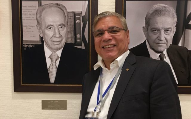 Nyunggai Warren Mundine during a recent trip to Israel, in front of portraits of former presidents Shimon Peres and Ezer Weizman.
