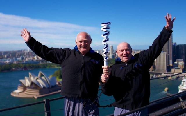 Maccabi Australia president Barry Smorgon (left) with the Australian Maccabiah team's head of delegation Tom York on Sydney Harbour Bridge with the Maccabiah torch. Photo: Robi Karp