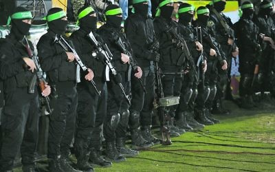 Fighters from Hamass Ezz-Al Din Al Qassam Brigades at last month's memorial service for Mazen Fuqaha. Photo: EPA/Mohammed Saber