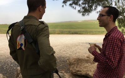 Nathan Jeffay (right) being briefed by an IDF captain on the Gaza border.