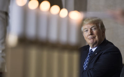 President Donald Trump watches the lighting of memorial candles during the annual Days of Remembrance Holocaust ceremony in the Capitol Rotunda on April 25, 2017. (Photo By Tom Williams/CQ Roll Call)