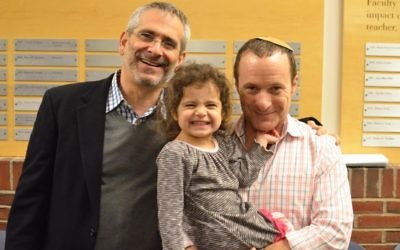 Rabbi Steve Greenberg (left) with his partner Steven Goldstein and their daughter.