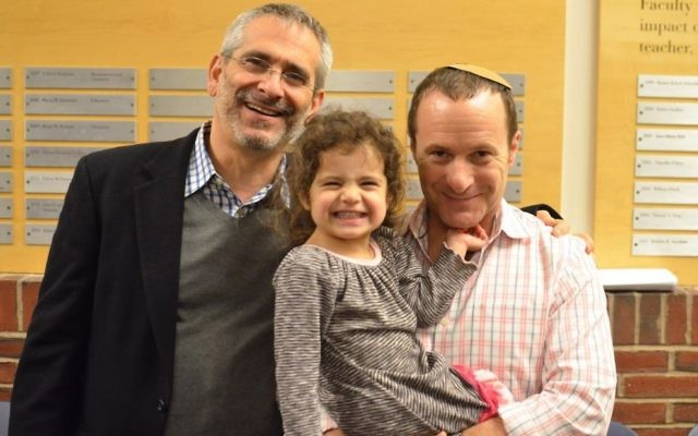 Rabbi Steve Greenberg (left) with his partner Steven Goldstein and their daughter.