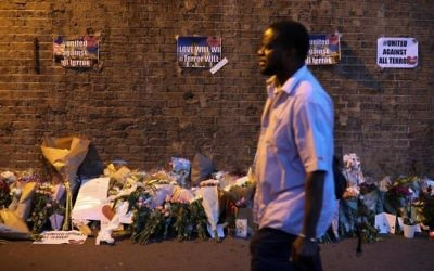 Tributes lain after the attack on pedestrians leaving the Finsbury Park Mosque.