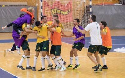 The Australian futsal team celebrating their last-minute victory over Brazil. Photo: Julie Kerbel