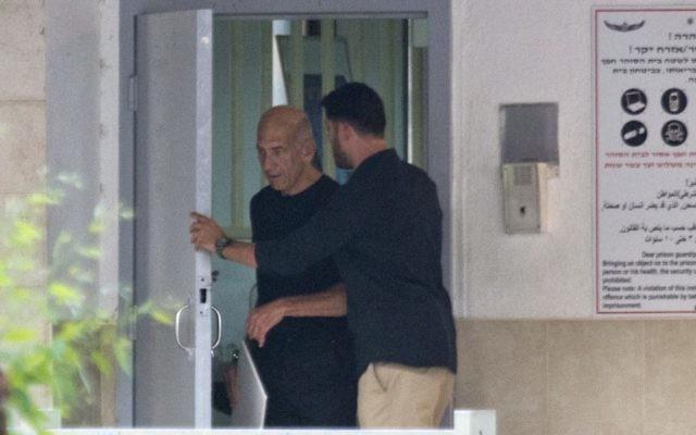 Former Prime Minister Ehud Olmert leaving jail.