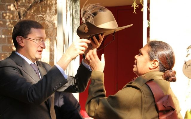Julian Leeser presenting a replica slouch hat to Elsie Amamoo.  Photo: Shane Desiatnik