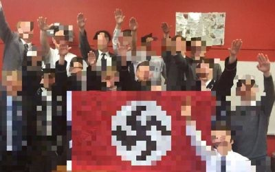 The offending photo of Shore students and their teacher in 2016 posing with a Nazi flag.