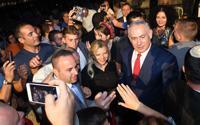 Prime Minister Benjamin Netanyahu's former chief-of-staff and his lawyer have been arrested in connection with a corruption probe, as well as a former cabinet minister. Photo: Kobi Gideon / GPO.