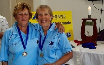 NSW teammates Sandy Desiatnik (left) and Maxine Brem, wearing their gold medals.