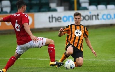 Charlton Athletic U23s player Ryan Blumberg (left) challenges for the ball against Hull City.