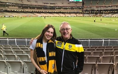 Tony Greenberg (right) supporting the Tigers with his daughter Emily.