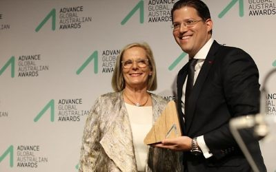 Jeremy Balkin (right) receives his award from Lucy Turnbull.