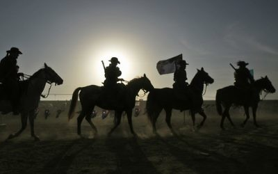Re-enactment of the cavalry charge at the 90th anniversary commemorations in Beersheba. Photo: AP/Ariel Schalit
