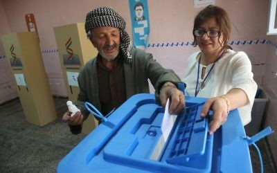 An Iraqi Kurdish man casts his vote in the Kurdish independence referendum. Photo: Shahbazi/Iran Images/Parspix/Abacapress.com.
