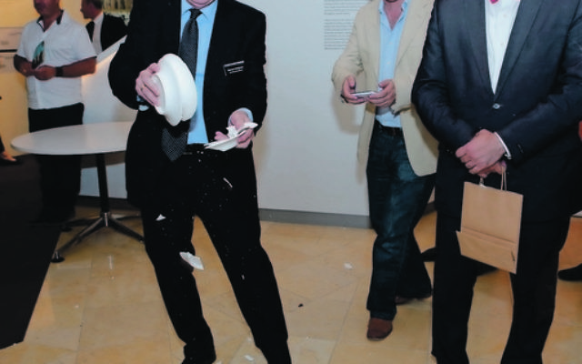 Norman Seligman and Dr Stavros Kyrimis throwing plates at the launch of the Jews of Greece exhibition at the Sydney Jewish Museum on October 24. Photo: Giselle Haber