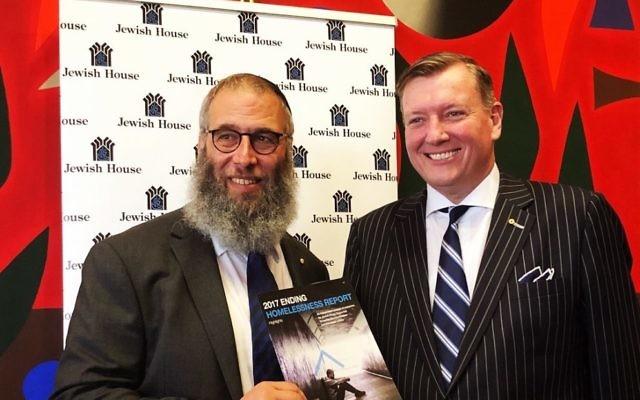 Rabbi Mendel Kastel (left) and Lifeline Australia chairman John Brogden presenting the 2017 Ending Homelessness Report to NSW Parliament.