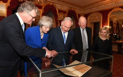 Israel's Prime Minister Benjamin Netanyahu and his wife Sara, with British Prime Minister Theresa May and Lords Balfour and Rothschild view the original Balfour Declaration. Photo: Kobi Gideon, GPO