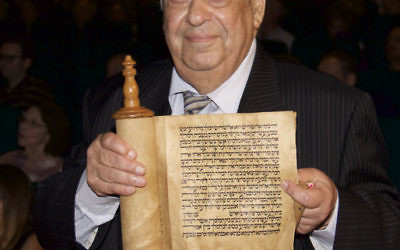 Iraqi-born Alfred Gubbay, president of the Sephardi Federation of Australian Jewry, holding a Megillah scroll from Baghdad. Photo: Wendy Lessick Bookatz
