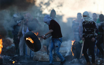 Palestinian protesters following the death of Ibrahim Abu Thurayya. Photo: AP Photo/Majdi Mohammed