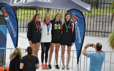 Ashley Weill (second from right) on the podium.