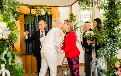 L'chaim! Dr Kerryn Phelps (left) kissing her wife Jackie Stricker-Phelps after the ceremony at Emanuel Synagogue last week. Photo: Same Love Photography