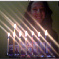 Sarah Ben-Simon lights Chanukah candles in Bolivia as mum Leonie watches on Skype.