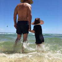 Raymond Rothschild and 4-year-old grandson Jacob Richardson enjoying Frankston beach.