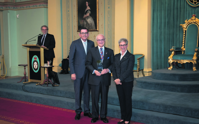 Paul Zimmet (centre) receiving his Victorian award from Premier Daniel Andrews and Governor Linda Dessau last October.