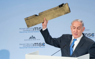 Benjamin Netanyahu holds a part of a downed drone during his speech at the Munich Security Conference. Photo: Lennart Preiss/MSC 2018/dpa via AP