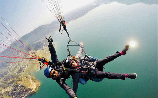 Debby Zwi paragliding with an instructor in Nepal is the winning entry in The AJN's holiday photo competition.