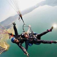 Anthony and Debby Zwi paragliding over Fewa Lake, Pokhara, Nepal.