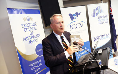 Colonel Richard Kemp with Alex Ryvchin's book, The Anti-Israel Agenda. Photo: Peter Haskin
