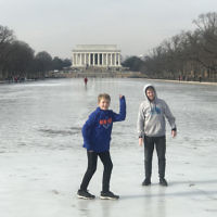 Tanya Kelly entered this photo of her sons on the frozen Lincoln Memorial Reflection Pool in Washington.