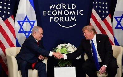 Bejamin Netanyahu with Donald Trump at Davos. Photo: Amos Ben Gershom, GPO
