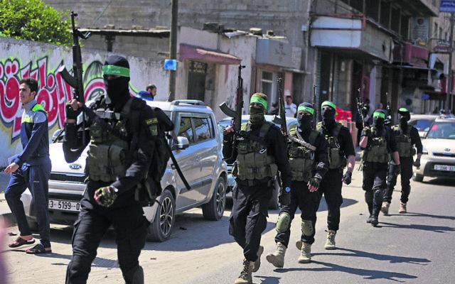 Masked militants from Hamas's Izzedine al-Qassam Brigades during Sunday's drill in Gaza. Photo: AP Photo/Khalil Hamra