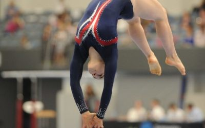 Deborah Greenbaum competing in artistic gymnastics.