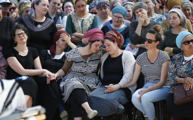 Family members mourn at the funeral of Adiel Coleman last Monday. Photo: EPA/Abir Sultan