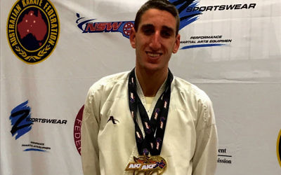 Yonatan Freund with his two gold medals at the 2018 Karate Australian Open.
