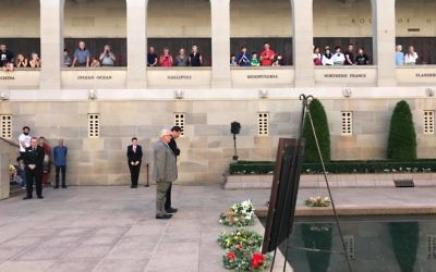 MPs Michael Danby (front) and Mike Kelly lay a wreath for Sergeant Albert Levy during his Last Post ceremony at the Australian War Memorial.