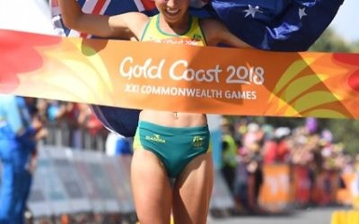 Jemima Montag crosses the finish line to win the Women's 20km Race Walk final on day four of competition at the XXI Commonwealth Games at Currumbin Beachfront on the Gold Coast, Australia, Sunday, April 8, 2018. (AAP Image/Tracey Nearmy) NO ARCHIVING, EDITORIAL USE ONLY