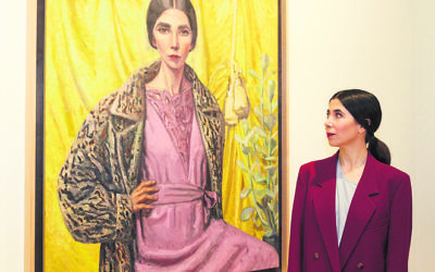 Yvette Coppersmith with her Archibald Prize-winning Self-portrait, after George Lambert.