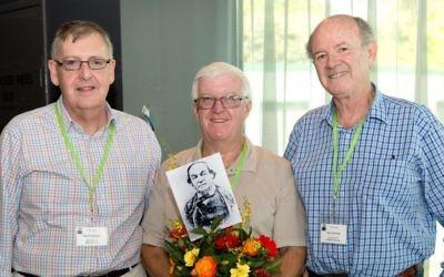From left: Sydney brothers Geoff Solomon, Adrian Paul and John Shrimski and a photograph of their ancestor Mordecai Solomon.